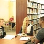 3 South College students in the library.