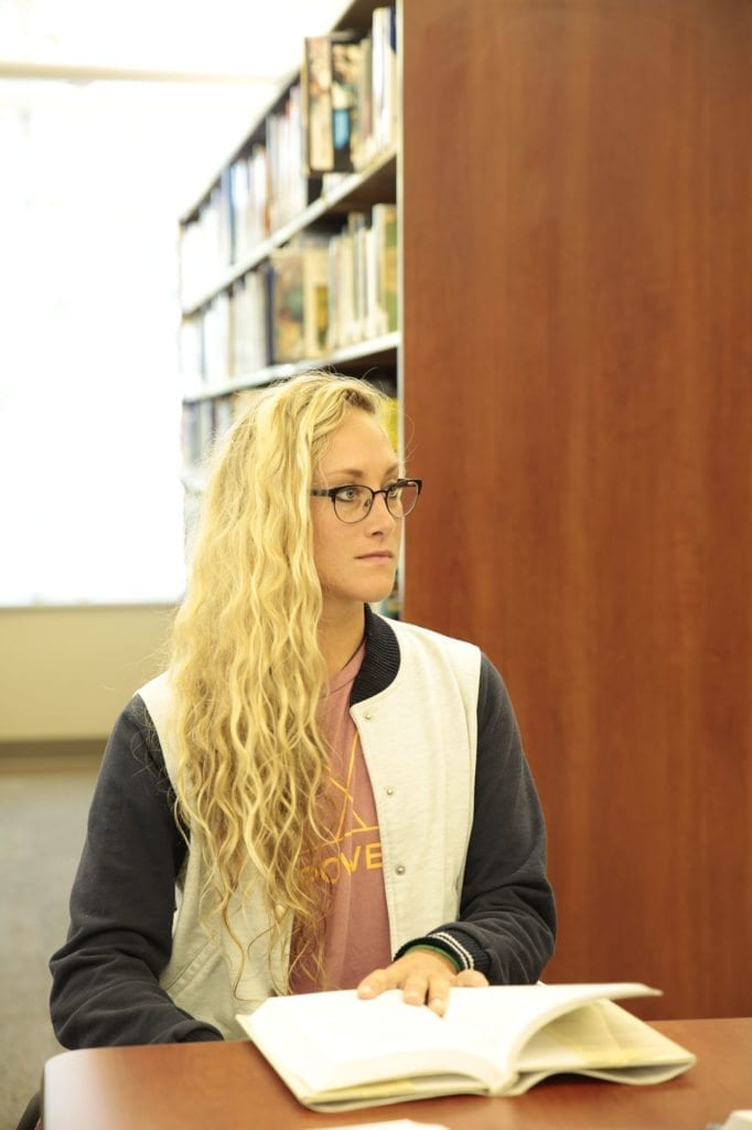 South College student in the library