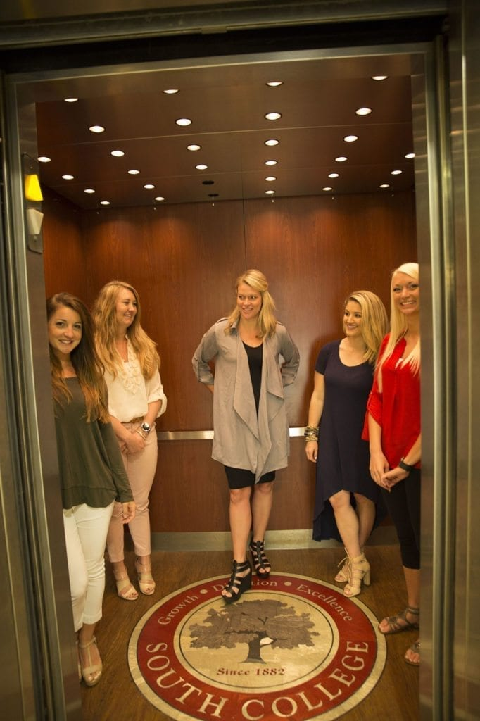 Students in Elevator at South College