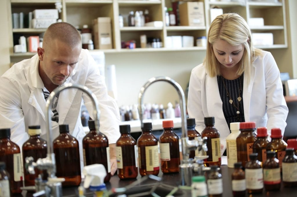 Two South College students in a chemistry lab.