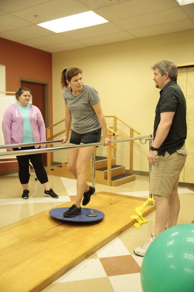 Group of South College students in a physical therapy lab
