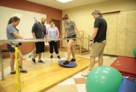South College physical therapy students in a physical therapy lab.