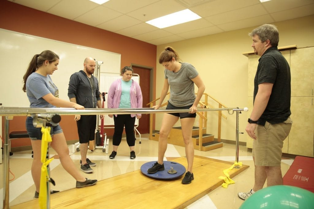 South College students working in a physical therapy lab.