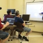 South College students in a classroom.