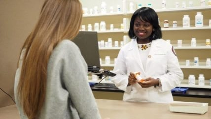 South College Pharmacy students in a pharmacy.