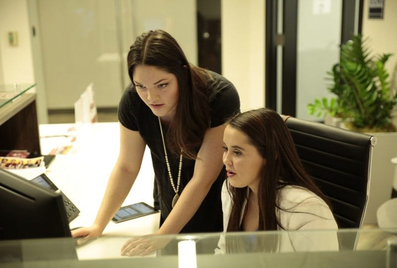 2 women on a computer at the South College Nashville Campus.