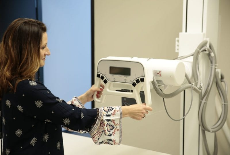 Woman working with medical equipment at the South College Nashville Campus.