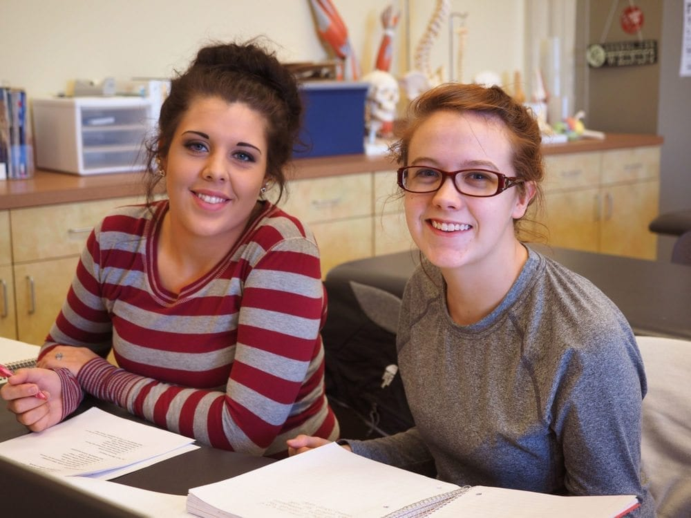 Two South College students pose for a picture during class.