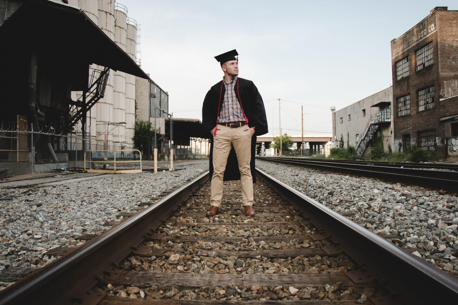 South College Graduate standing on the Knoxville railroad.
